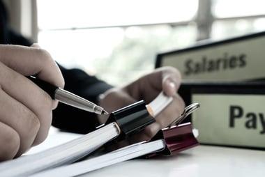 financial paperwork for compensation management